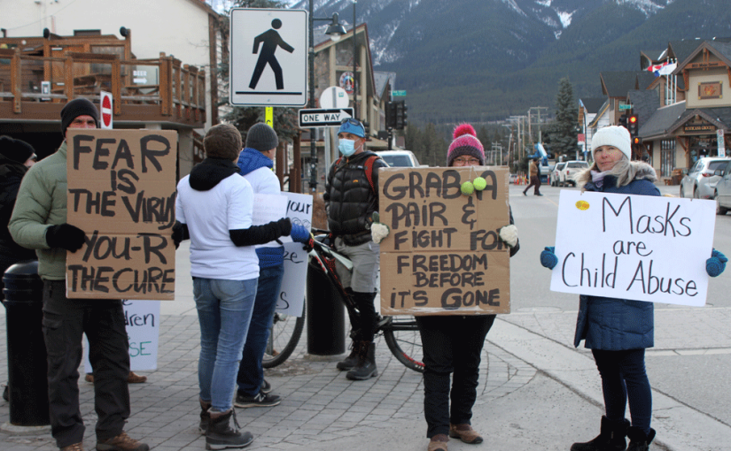 Ethicists debate whether anti-mask protestors should forfeit COVID-19 medical care